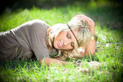 lying in spring grass senior model photo durango co