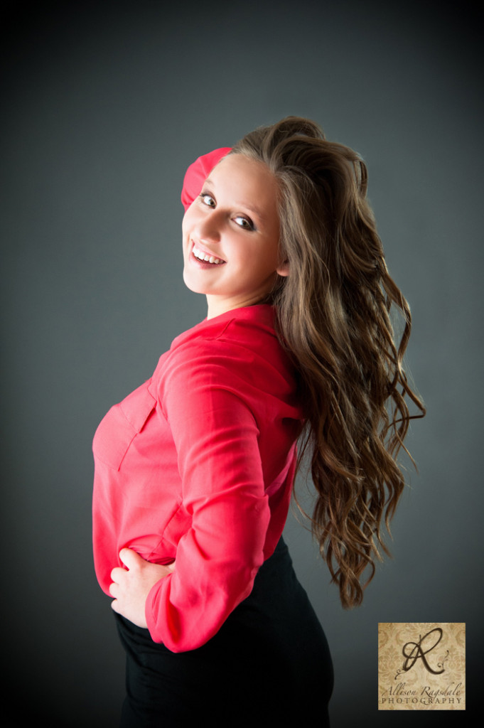 red shirt grey studio pic long hair senior girl