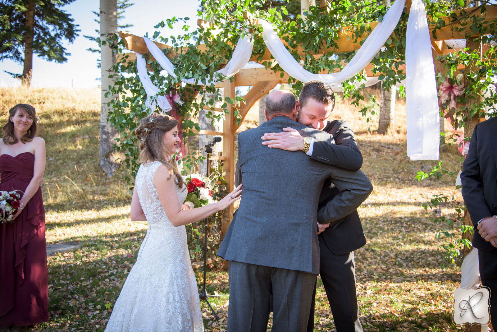 Father walking bride down isle