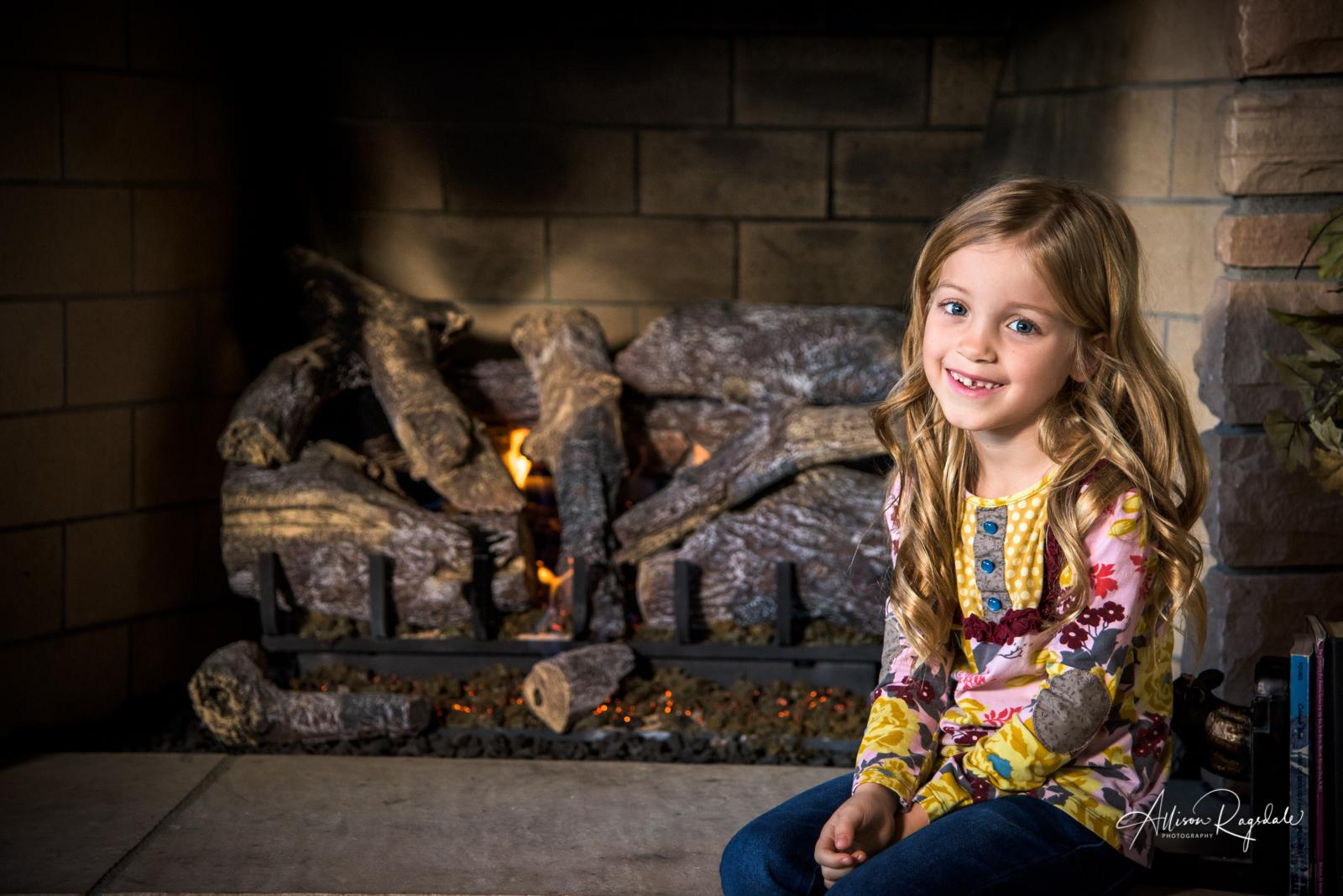 indoor fireplace family portraits in Durango Colorado