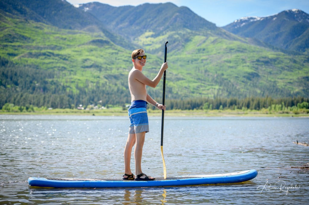 adventure senior pictures paddleboarding