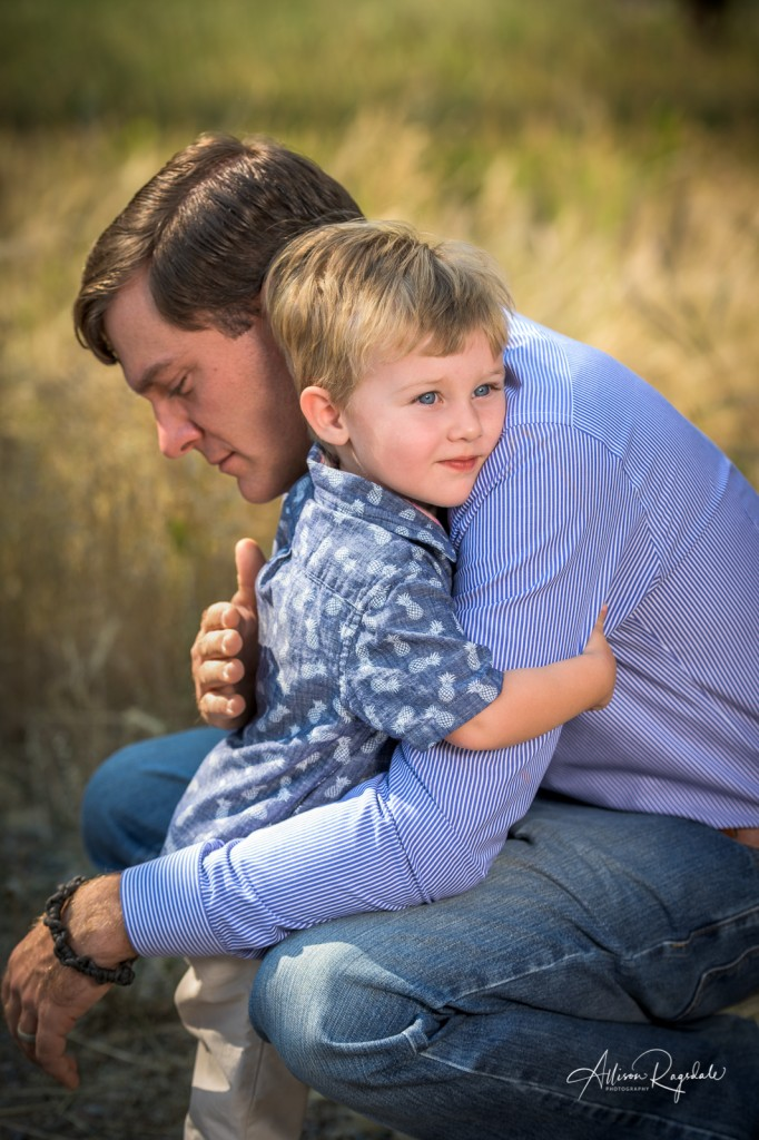 Dad and son hugging, The Fisher Family Portraits