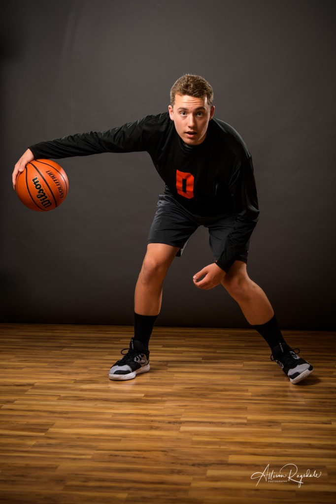 Indoor basketball senior pictures with gray background