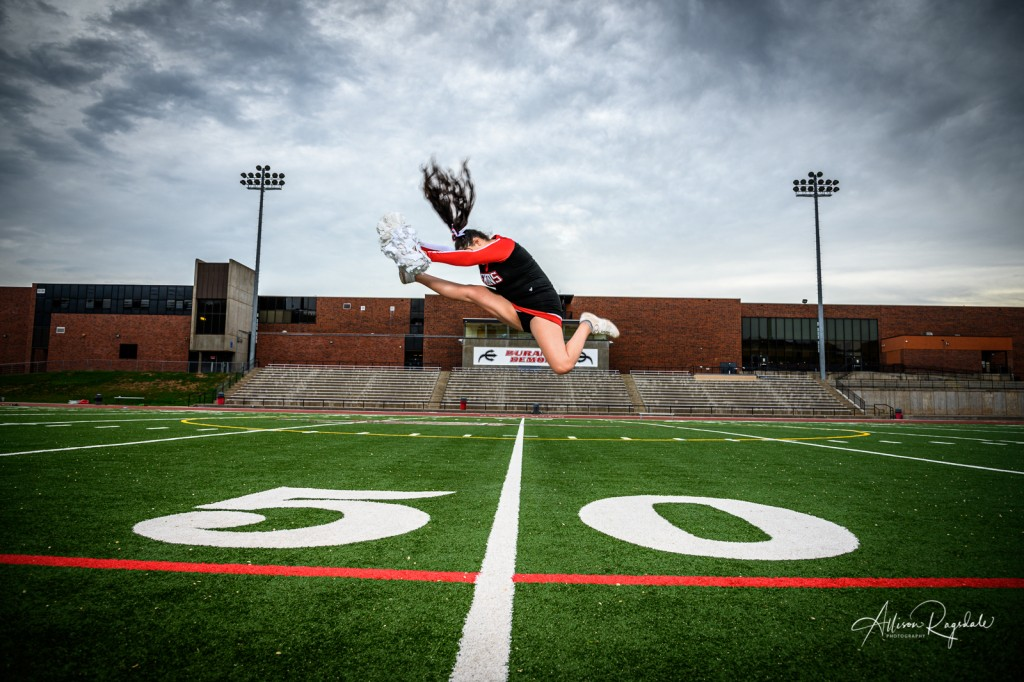 Amazing senior pictures of cheerleading on football field
