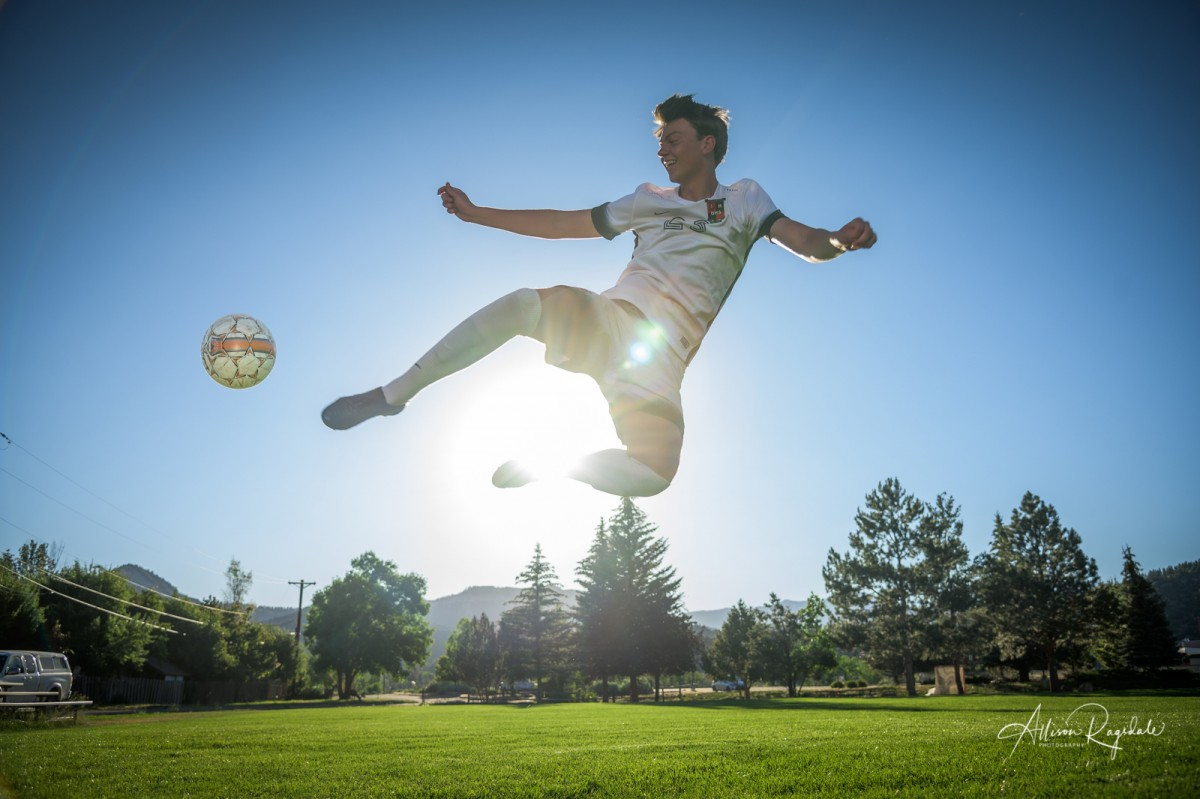 Amazing senior portraits with soccer player in Durango Colorado in morning