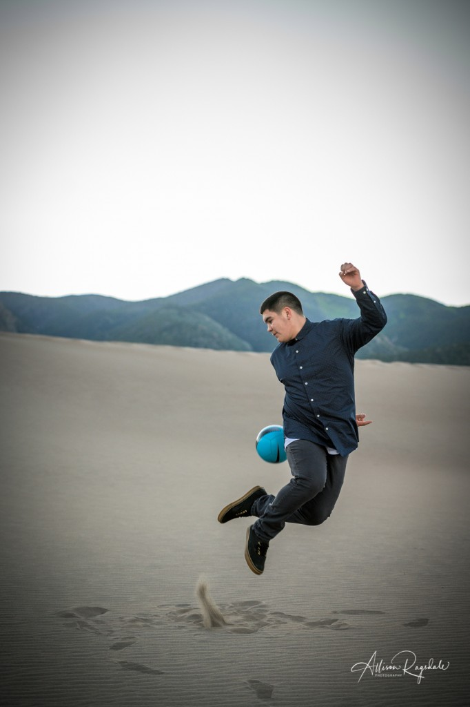 Cool soccer senior pictures in sand