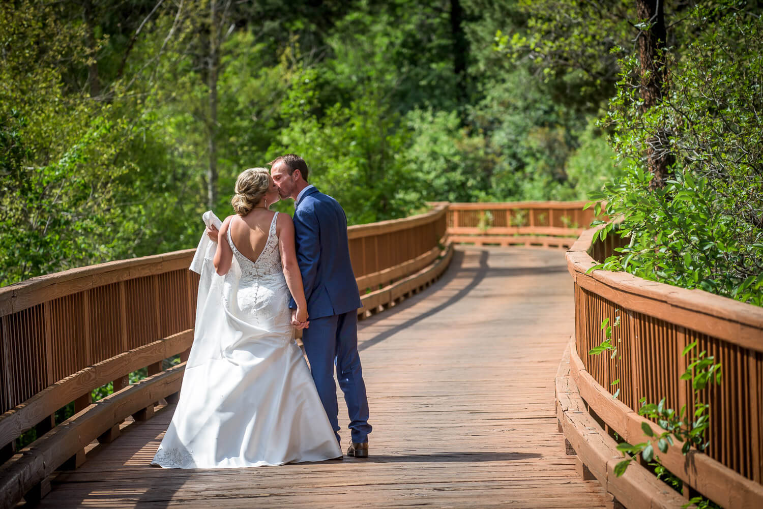 Bride & Groom's first look on the bridge at the Glacier Club for their Durango Wedding pictures