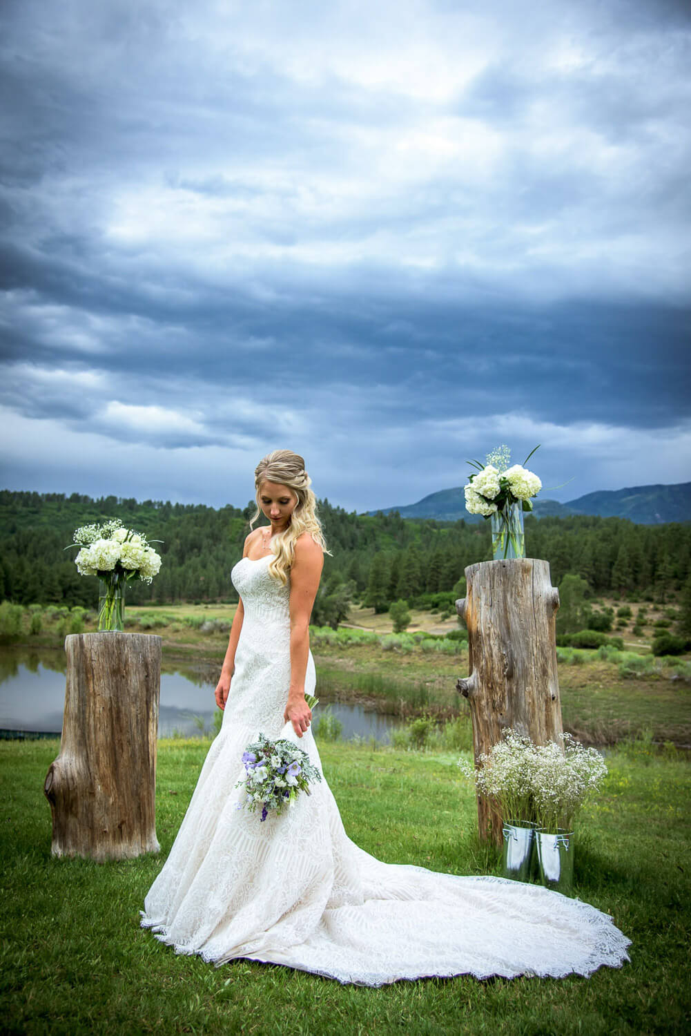 Bridal portrait in lace wedding dress with train at her Durango Silver Mountain Guest Ranch wedding