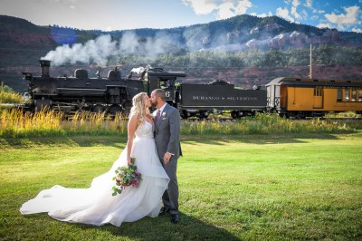 Bride and Groom wedding picture in front of Durango Silverton Railroad Train passing by at River Bend Ranch