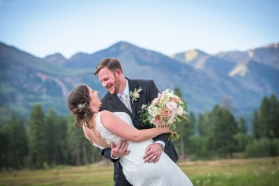 Bride and Groom dance picture with mountains in the background at Vallecito Reservoir Durango Colorado