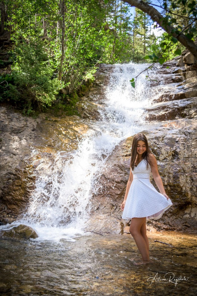 Amazing senior pictures with waterfall in Durango