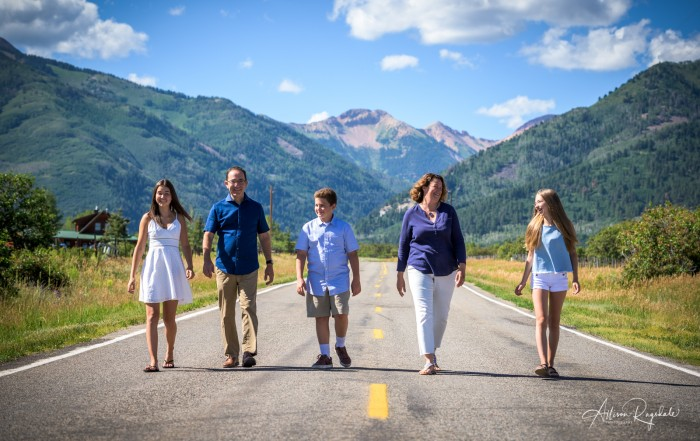 Family pictures in the mountains with road