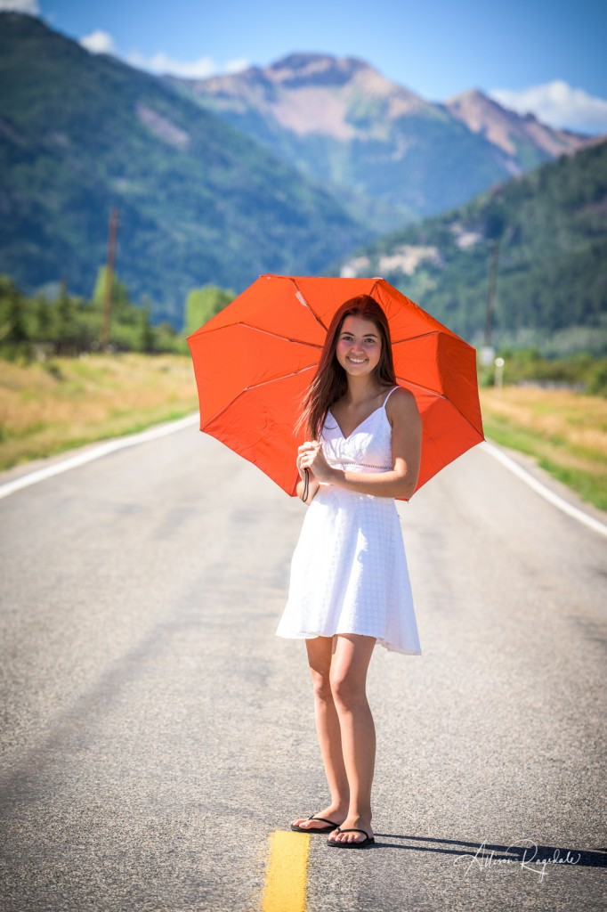 Adorable senior pictures with mountains and umbrella