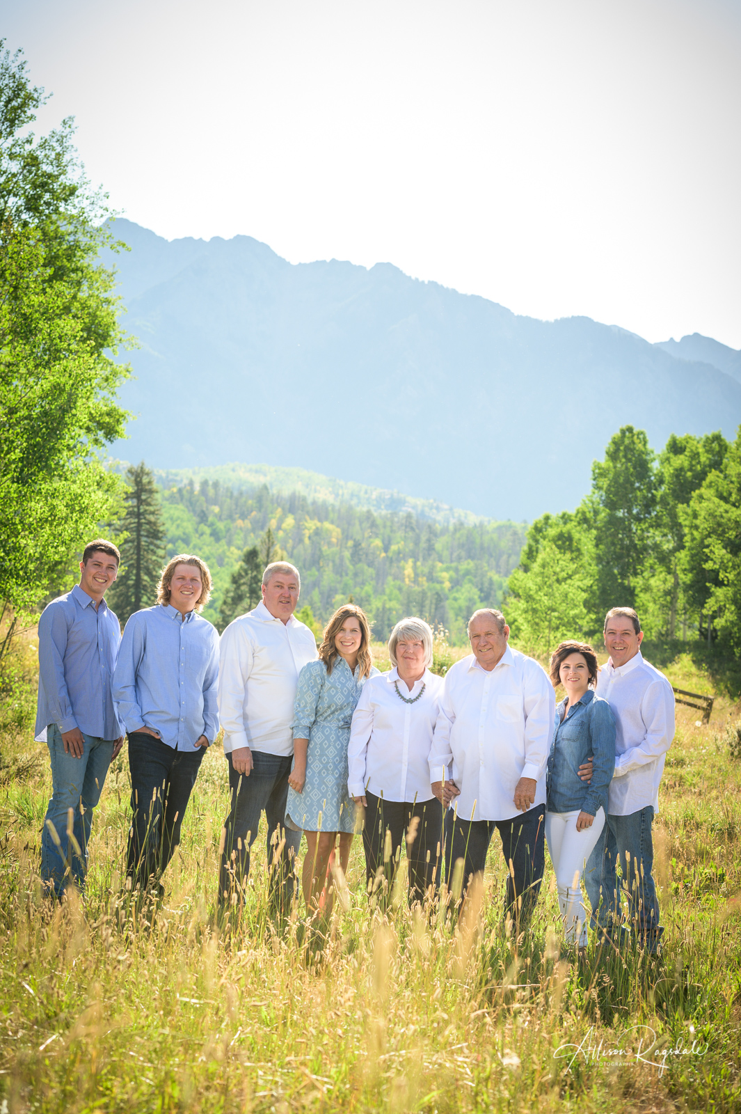 Gorgeous family pictures with long grass field