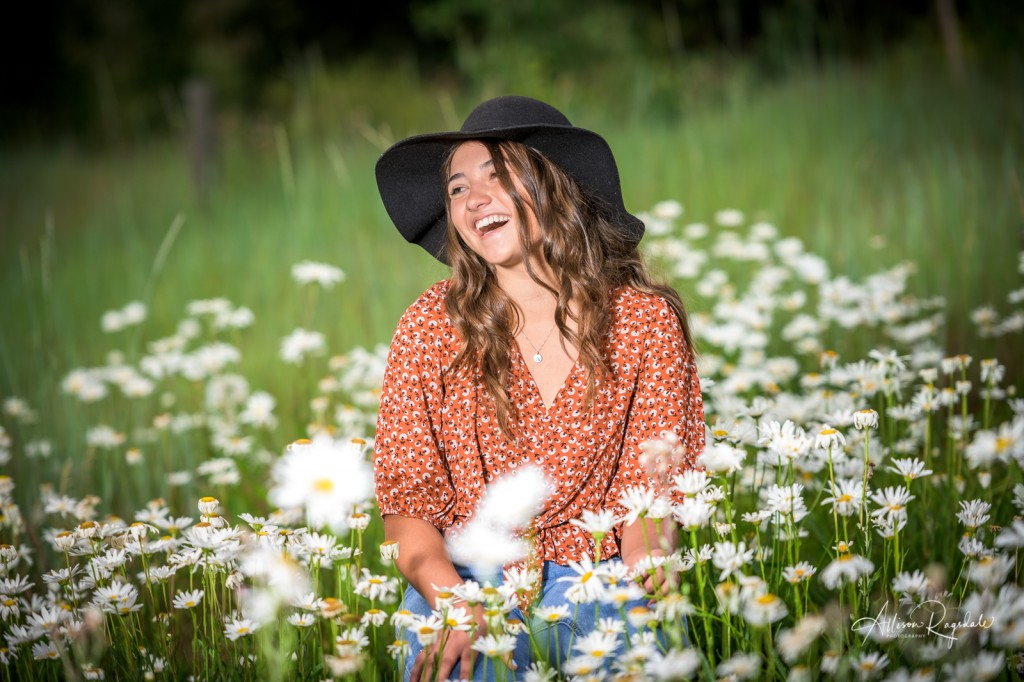 Senior pictures in field of flowers