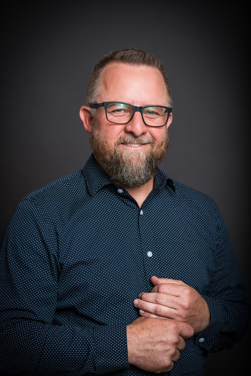 Headshot on guy on Black Background in Durango Colorado. Photo by Allison Ragsdale Photography