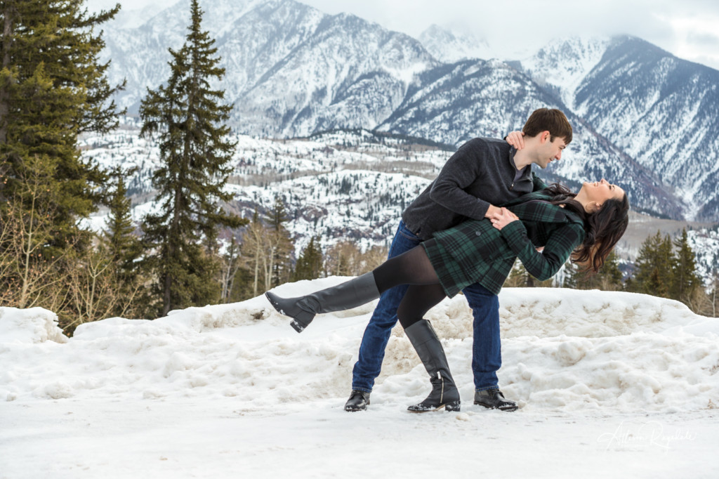 Sweet engagement photos in snowy mountains