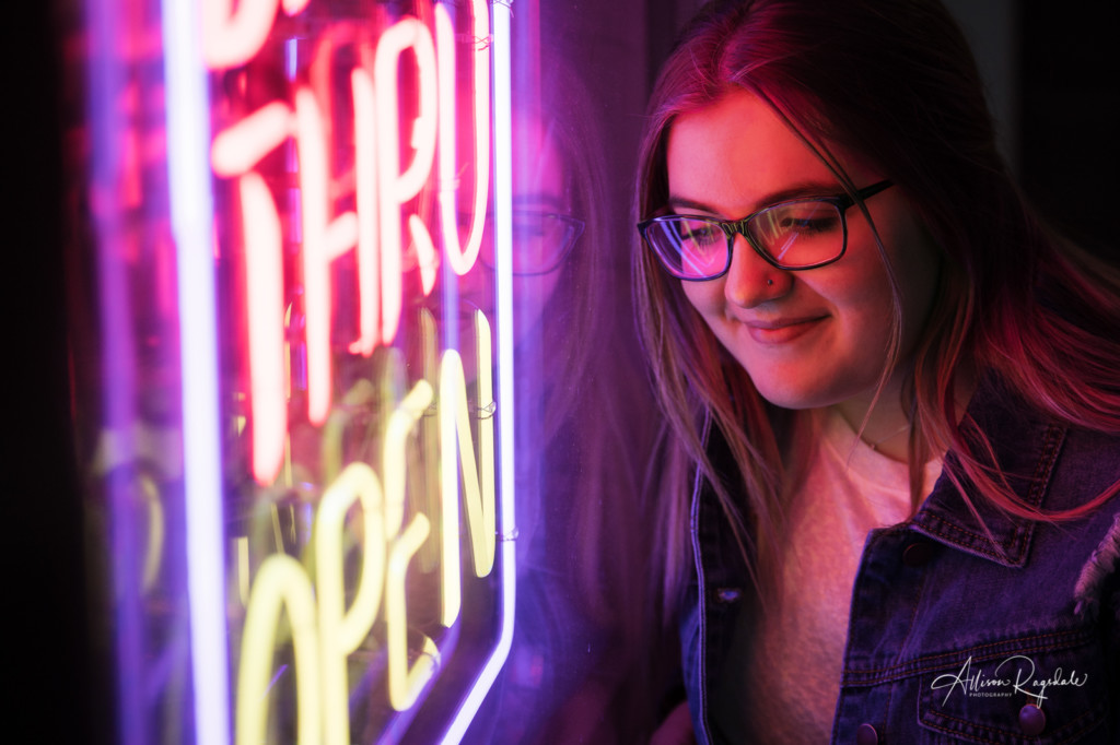 Senior pictures with a neon sign