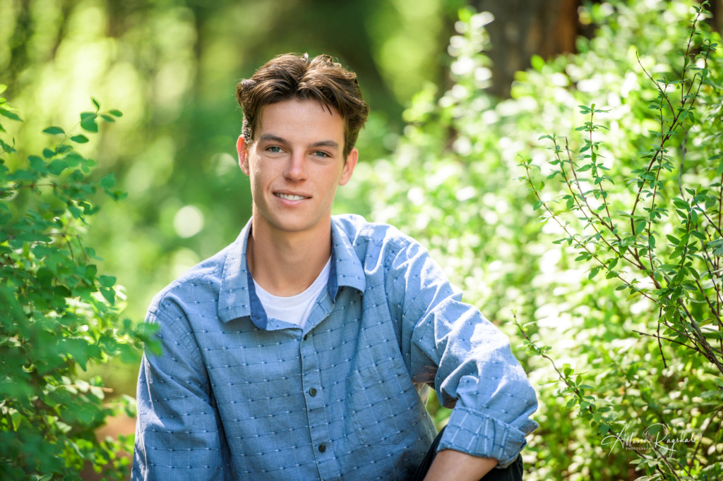 Senior pictures in green forest in Colorado