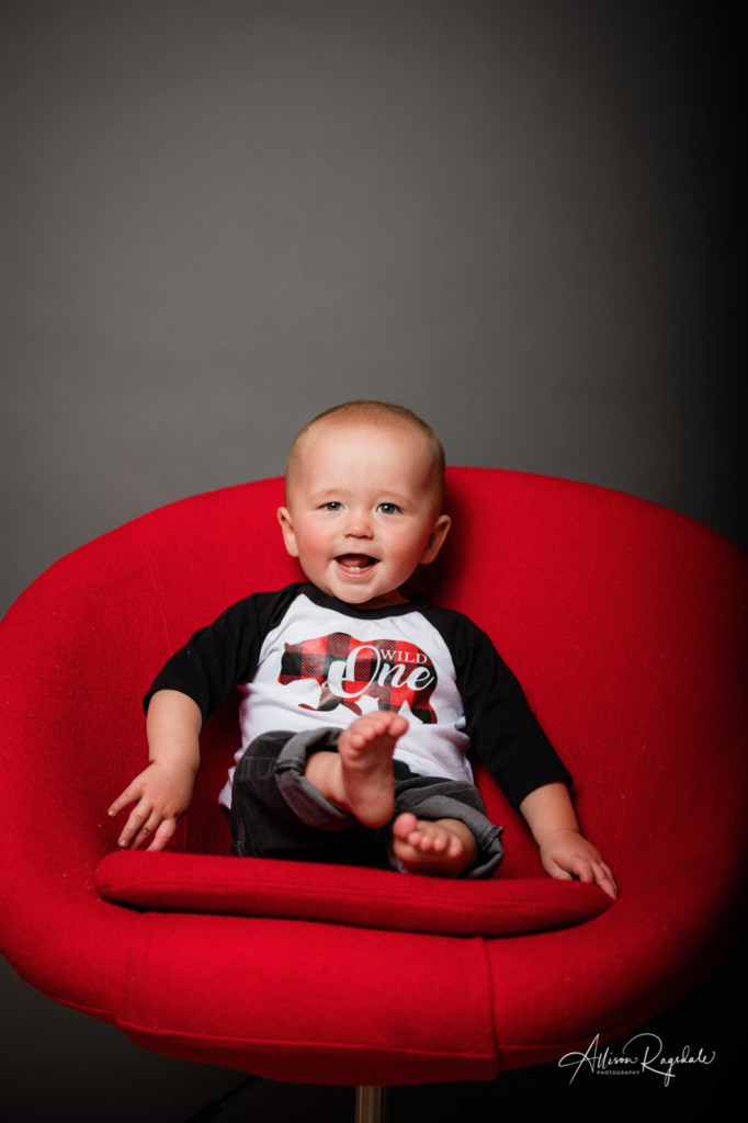 cute baby in red chair