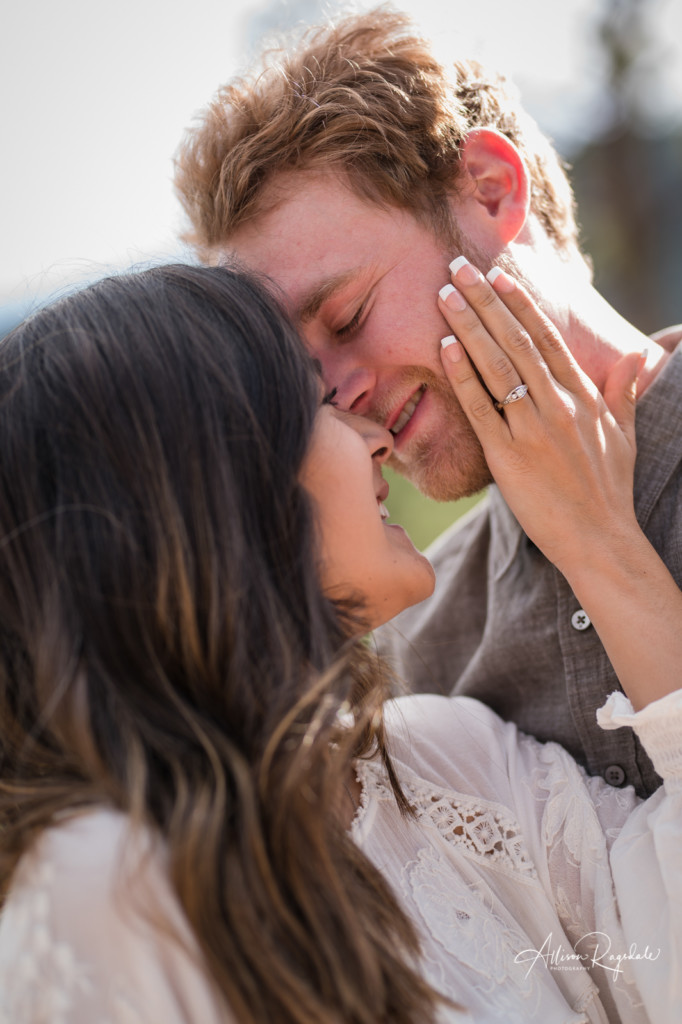engagement portrait with ring hand on face