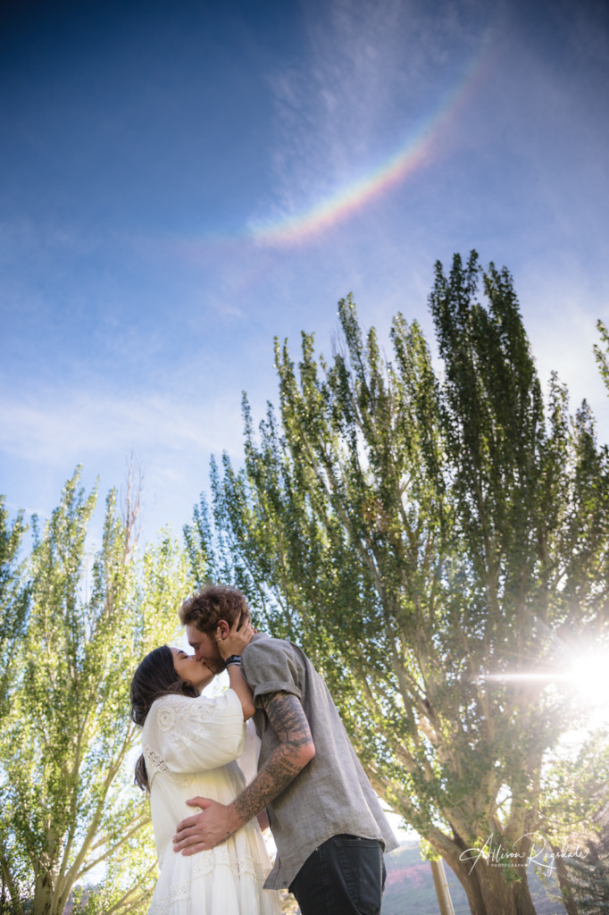 rainbow engagement kissing picture