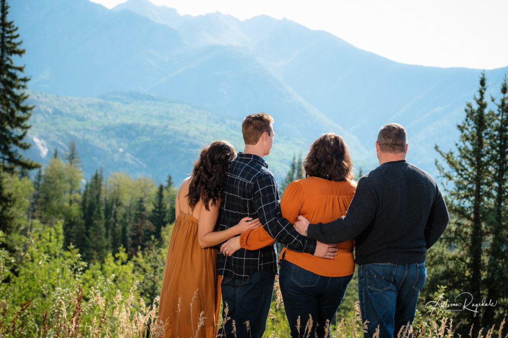 family pic looking at the mountains in colorado