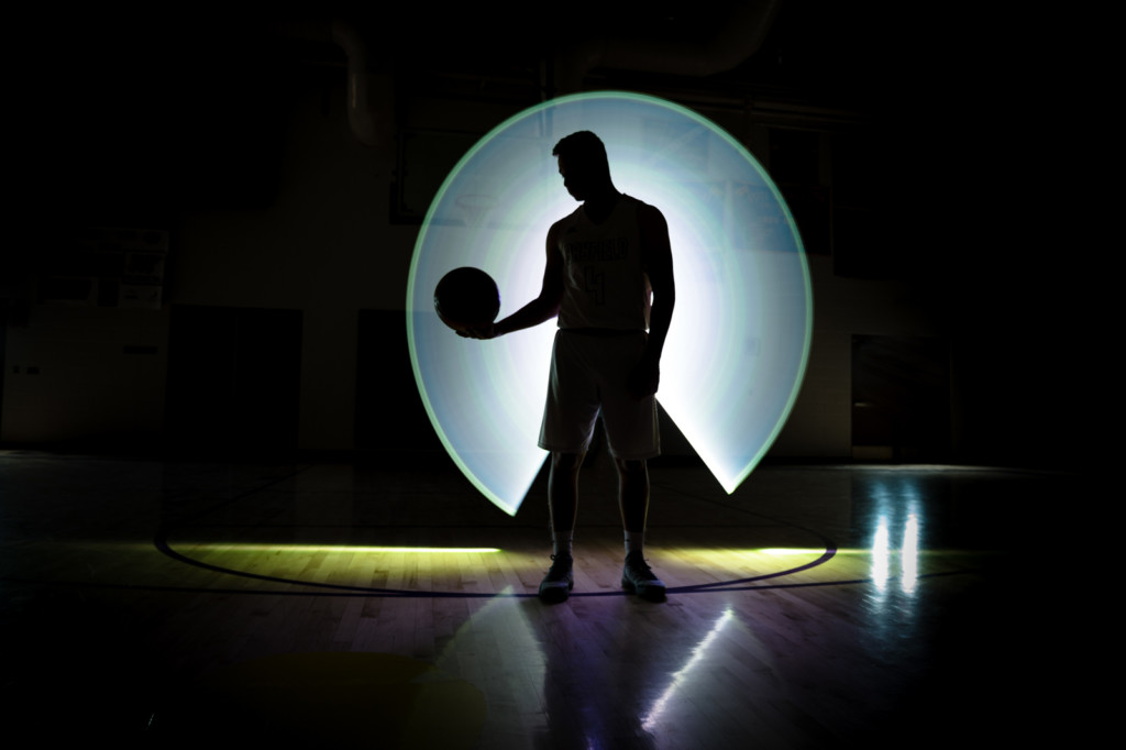 senior guy basketball silhouette with light painting