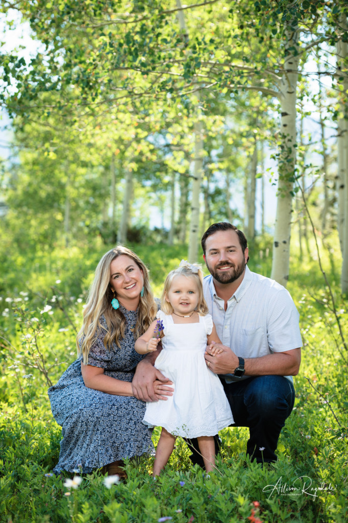 aspen tree colorado family picture with little girl in white dress