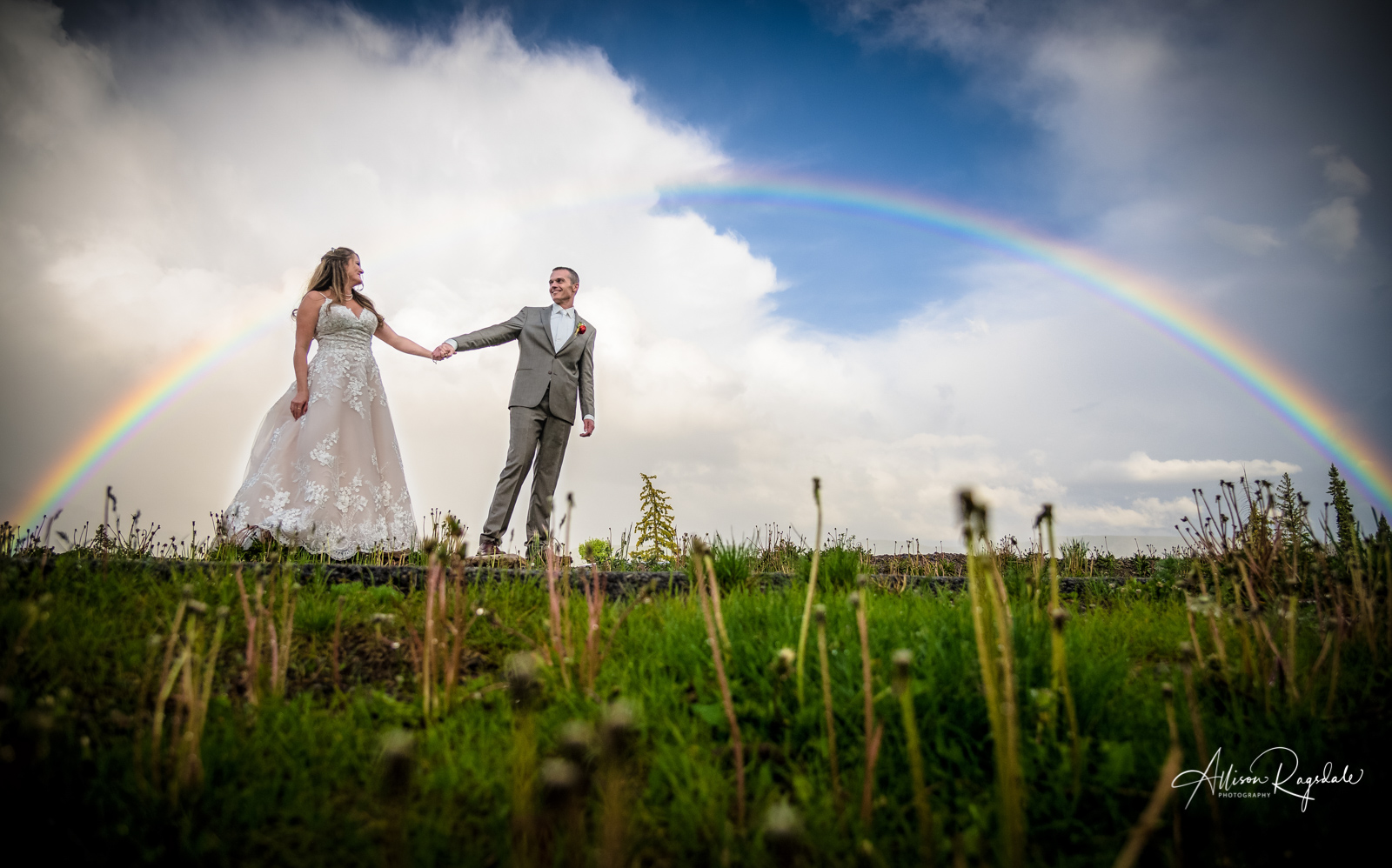 bride and groom portrait with full rainbow purgatory mountain wedding