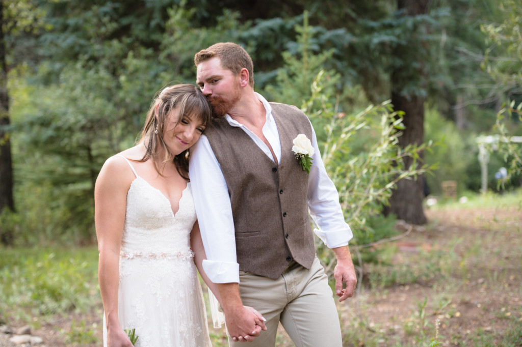 bride and groom forehead kiss while walking picture dolores colorado