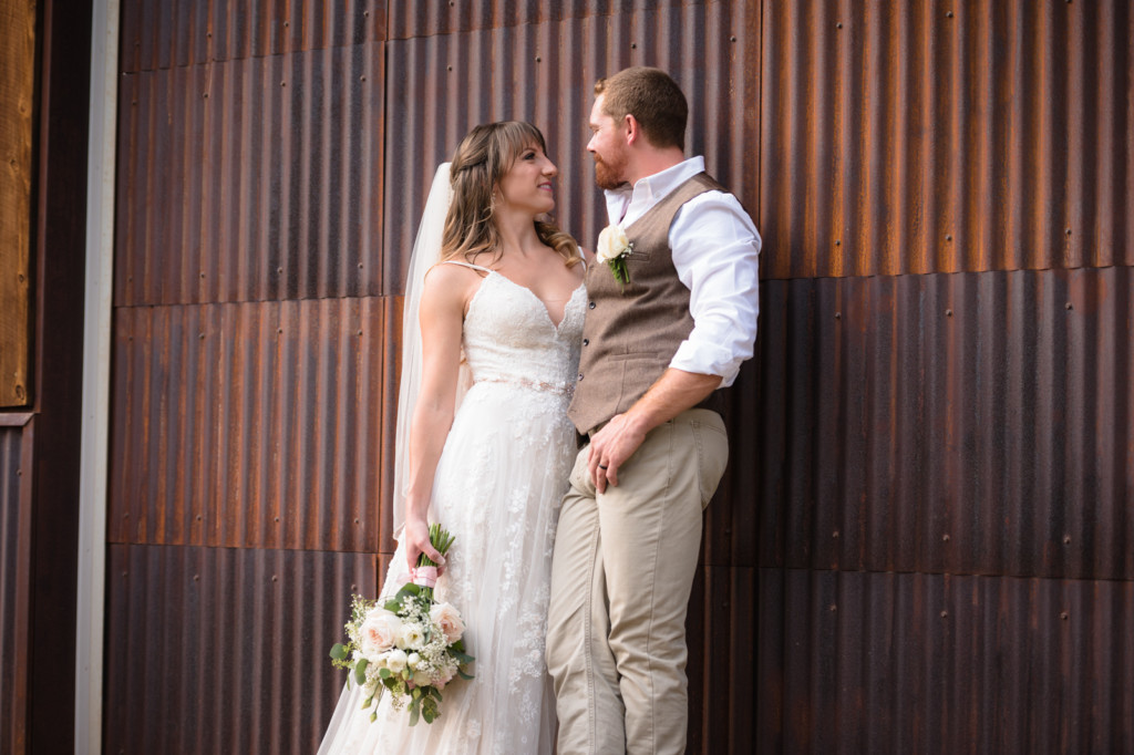 bride and groom on rusted aluminum wall portrait