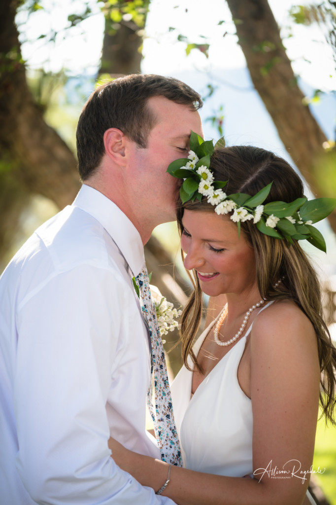 bride and groom flower crown kissing forehead picture