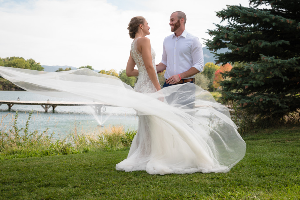 dress blowing in wind bridal portrait river bend ranch colorado