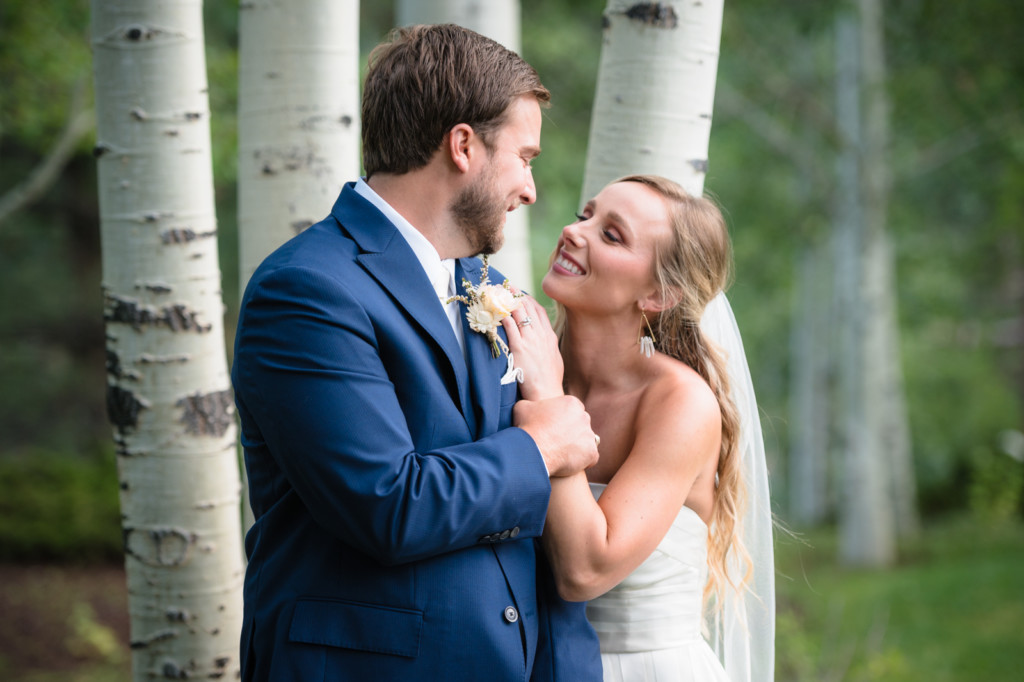 bride & groom looking at each other at glacier club in aspen trees
