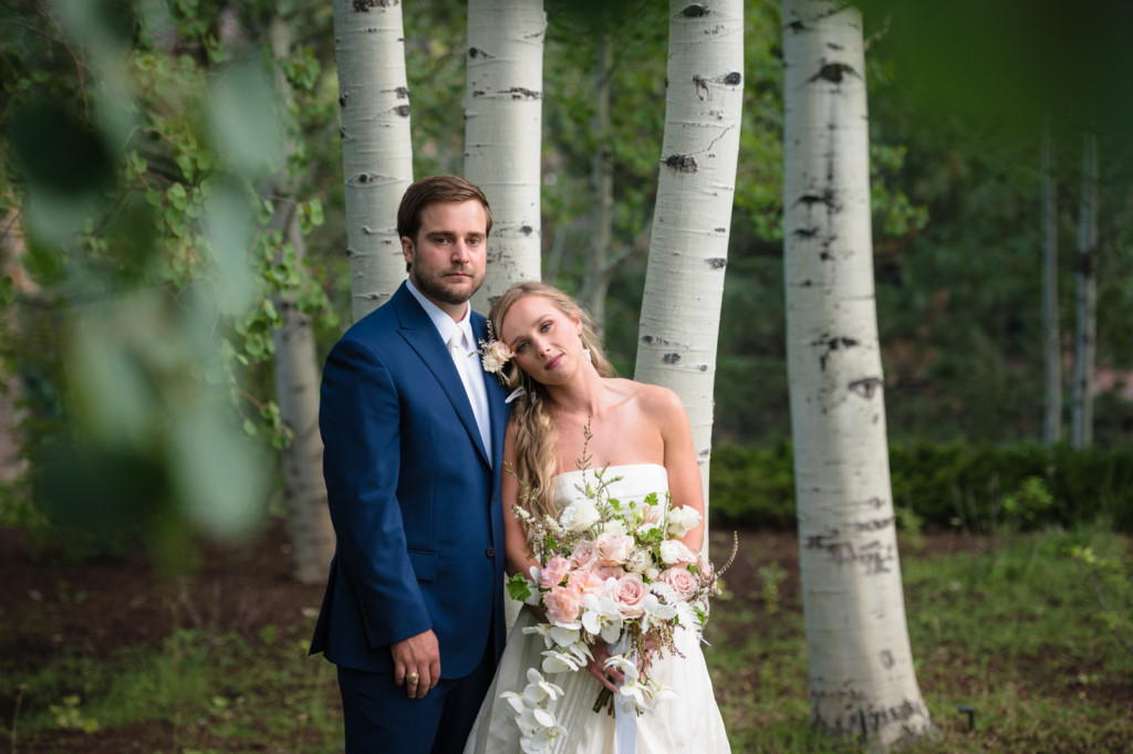 serious faces bride & groom portrait wedding day in aspen trees