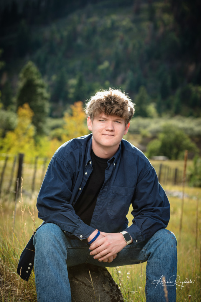 senior picture guy on rock fall colors durango co
