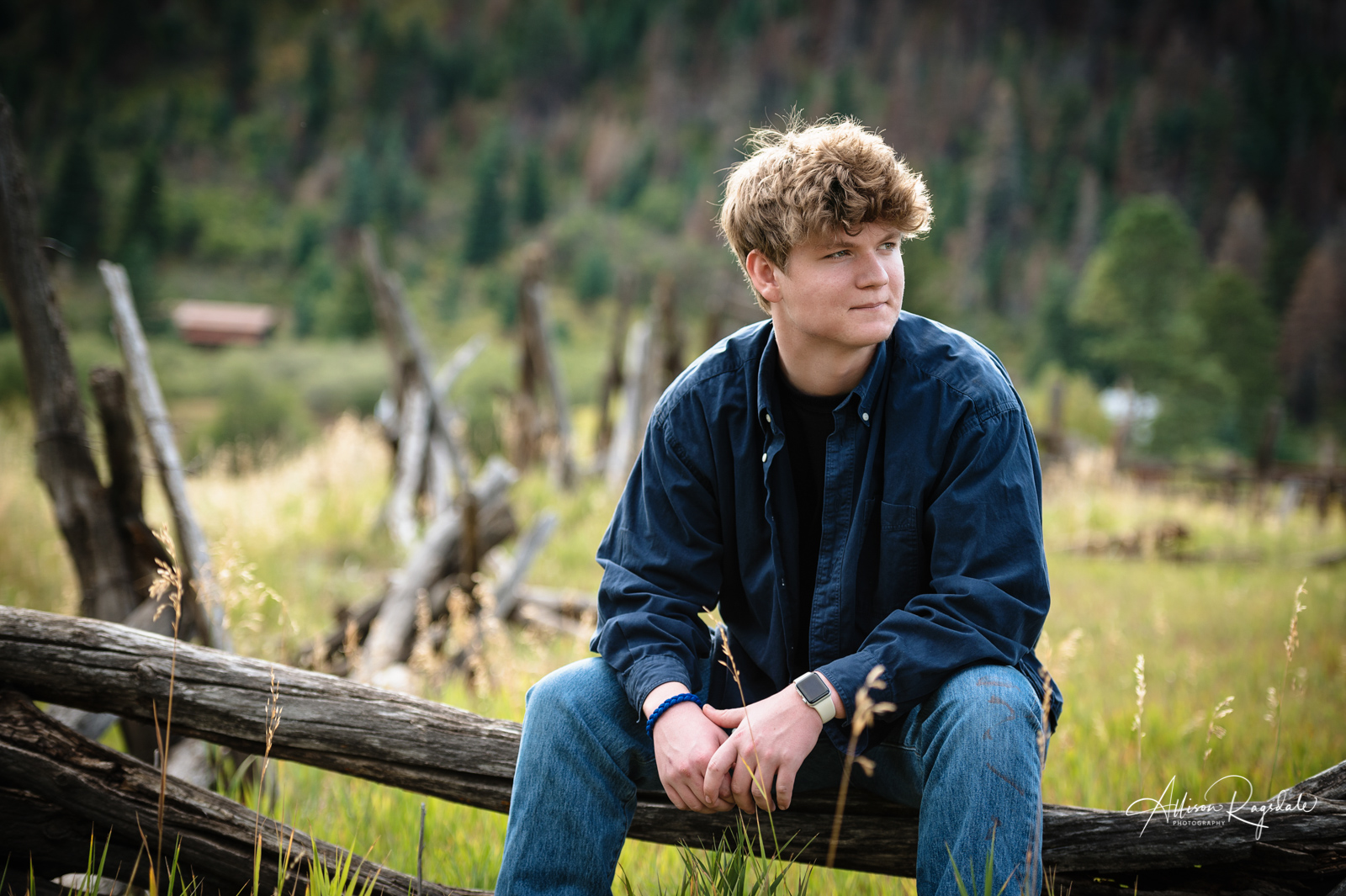 senior guy portrait rustic wood fence