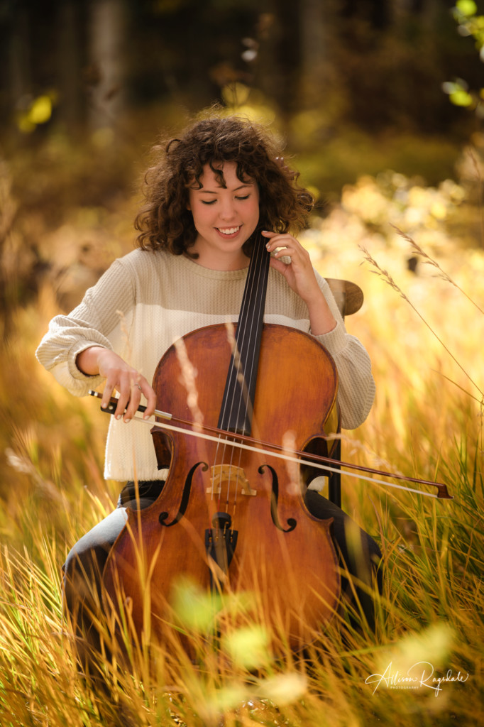 senior girl picture playing cello in long fall grass