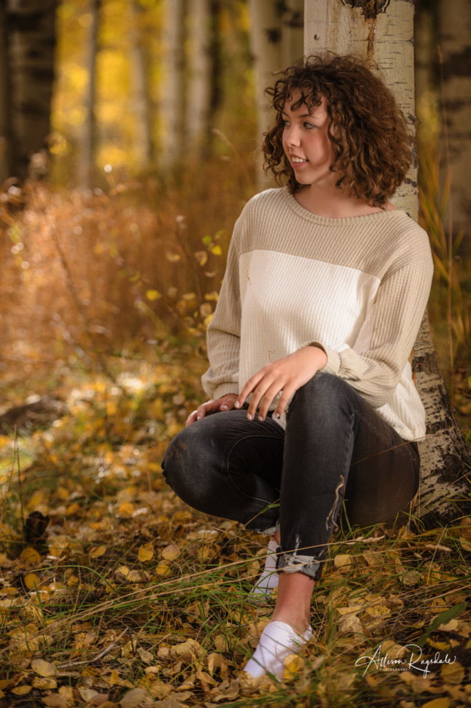 curly hair with bangs senior girl picture aspen trees