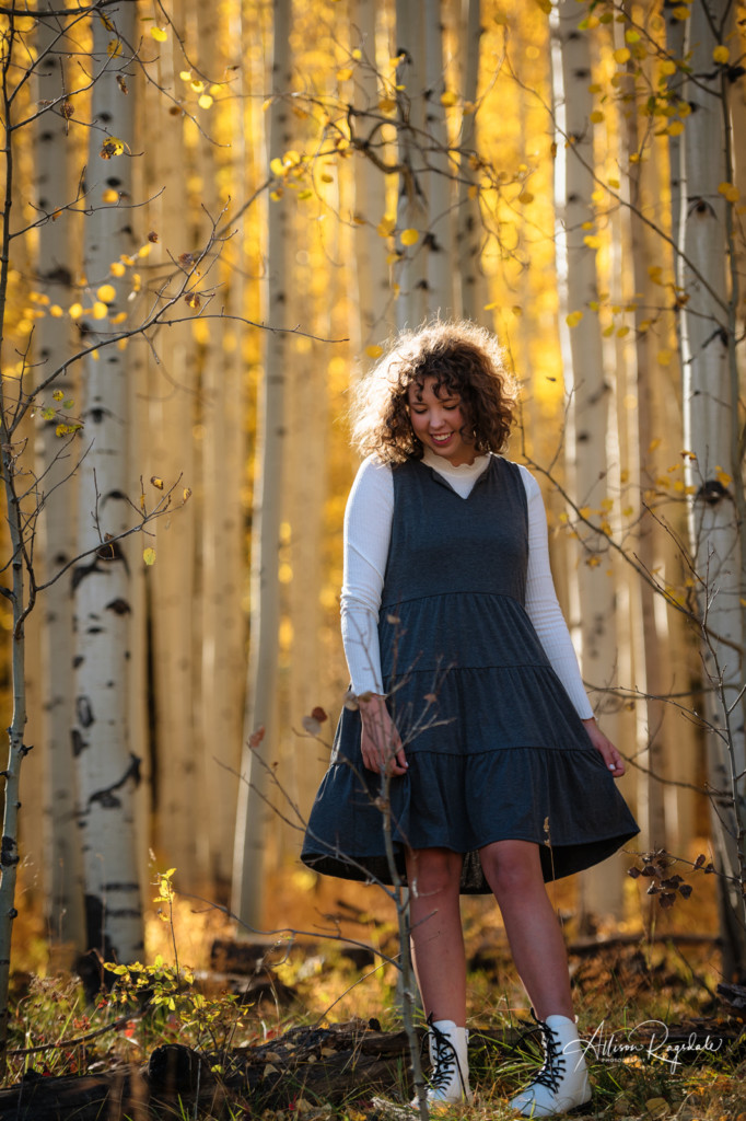 twirling in aspen trees fall colors senior picture