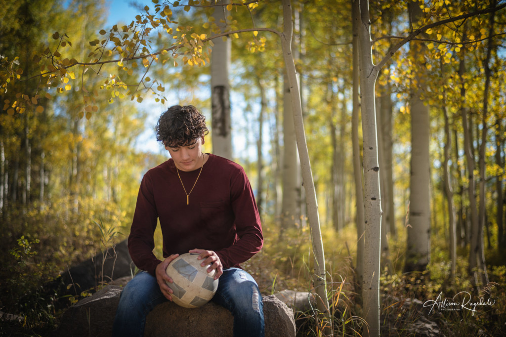 soccer player in fall color aspen trees senior boy pic
