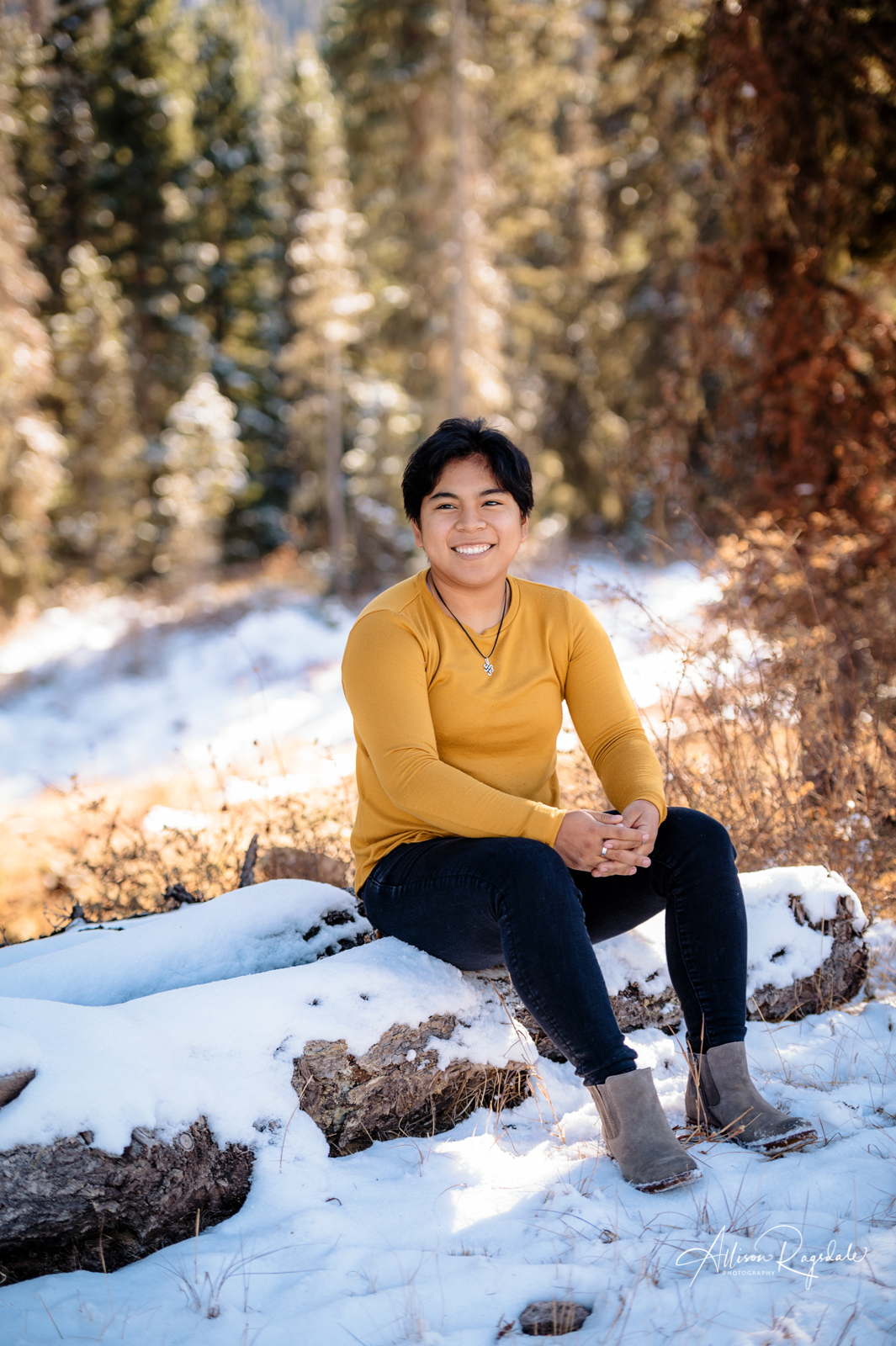 senior picture in the snowy forest colorado