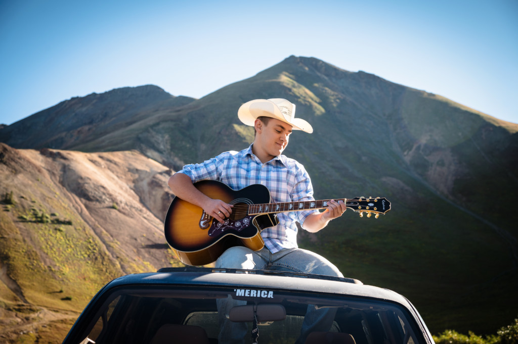 merica senior guy photo with guitar and cowboy hat in the colorado mountains picture