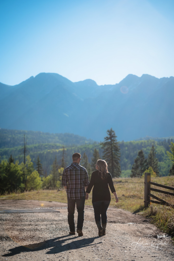 needles mountain range colorado engagement couple walking away