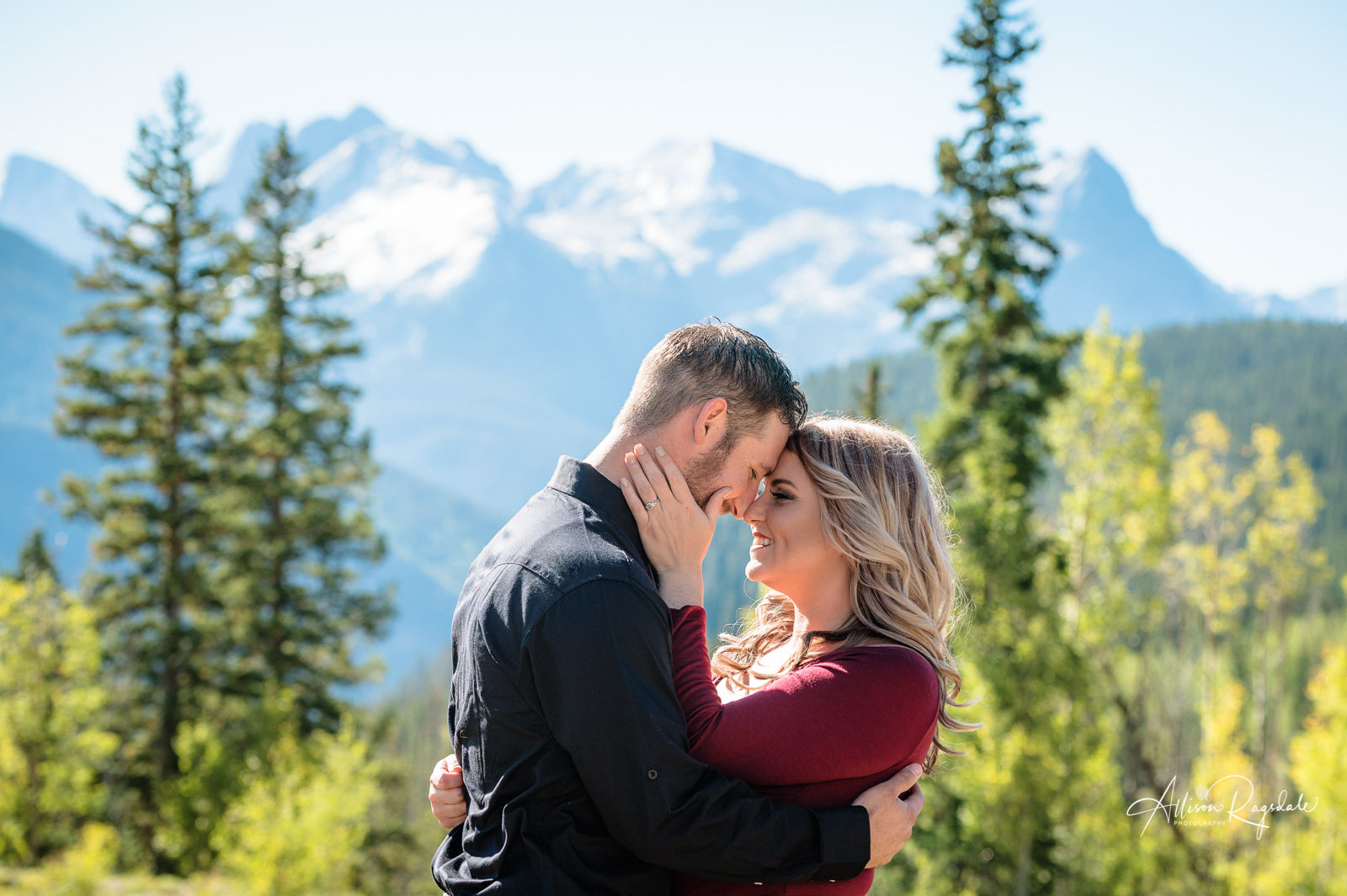 engagement couple portrait colorado mountains in the fall