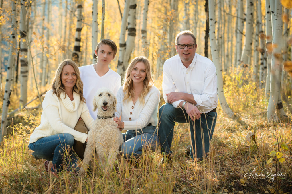 senior girl photo with family and dog in fall aspens