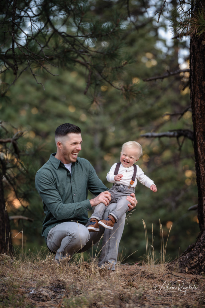 dad and son laughing picture colorado pine trees