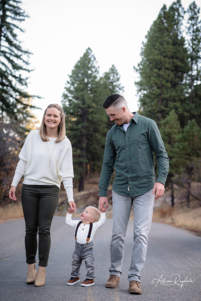 son looking up at mom walking family picture