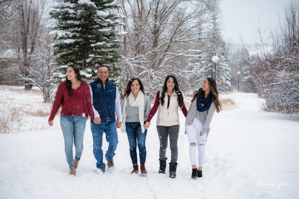 family portrait walking on river trail in the snow durango colorado